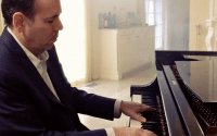 Perillo Tours Puccini Commercial features Steve Perillo playing an elegant black baby grand piano in the parlor of his own home (video produced by Merging Media).