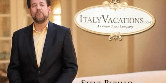 Perillo Tours Italy Vacations Commercial features Steve Perillo standing in his black sport coat and buttercream button down next to a word bubble that reads, ItalyVacations.com, A Perillo Tours Company (video produced by Merging Media).