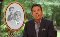 (Steve Perillo) Man in a sports jacket and grey button up against a backdrop of lush trees, sits next to a old family photo in this commercial for Perillo Tours 70 Years (video produced by Merging Media).