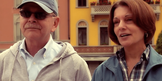 Perillo Tours Italy Testimonials captures a good looking older couple taking a break from touring Italy to comment on their amazing Italian tour provided by Perillo Tours (video production by Merging Media).