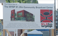 Construction site poster of the WYEP 91.3 fm Community Broadcast Center new building, Merging Media captures this construction in a fast photo movie (video production by Merging Media).