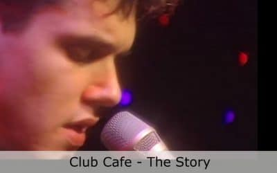 A close up of John Mayer singing into a microphone at Club Cafe (video produced by Merging Media)