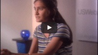USWeb 20th Century Fox Case Study video thumbnail shows a young woman with long dark hair, half pulled back, sits for an interview, logo on the wall in the background reads; USWeb.