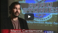 USWeb Harley Davidson News Feature thumbnail of KDKA Pittsburgh TV news station interview with Marco Cardamone, backdrop projection screen reads; Road Stories 95th Anniversary, Harley Davidson Motor Company.