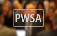 Mayor Peduto PWSA video thumbnail features blurred figure of a man in a suit sitting in front of background of an also sitting audience, the large text in the foreground in light grey font reads; PWSA (video produced by Merging Media).