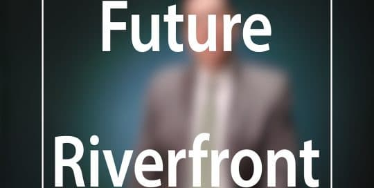 Mayor Peduto Future Riverfront Development campaign; Blurred figure of a man in a suit sitting in front of a very dark blue background, the large word in the foreground in white text reads; Future Riverfront (video produced by Merging Media).