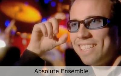 Club Cafe Absolute Ensemble features conductor Kristjan Järvi, in blue tinted glasses, speaking to the camera about his Absolute Ensemble and the performance at Club Cafe in Pittsburgh, Pennsylvania (video produced by Merging Media).